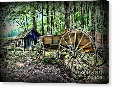 Wagon At The Cabin Canvas Print by Paul Ward