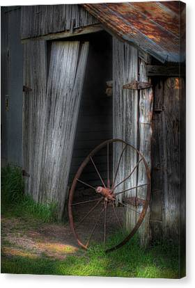 Wagon Wheel And Barn Door Canvas Print by David and Carol Kelly