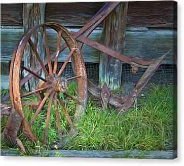 Canvas Print featuring the photograph Wagon Wheel And Fence by David and Carol Kelly