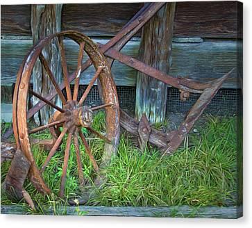 Wagon Wheel And Fence Canvas Print by David and Carol Kelly