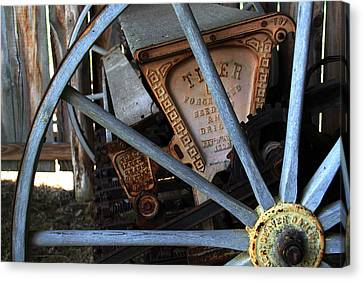 Wagon Wheel And Grass Seeder Canvas Print by Joanne Coyle