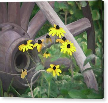 Wagon Wheel Canvas Print by Ernie Echols
