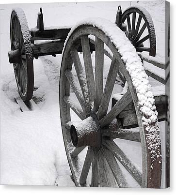 Wagon Wheels In Snow Canvas Print by Linda Drown