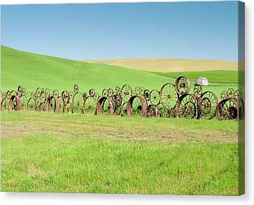 Wagon Wheels Stacked Palouse Washington Canvas Print by James Hammond