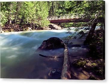 Walk Bridge Over A Swollen River Canvas Print by Jeff Swan