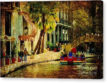 Walking Along The Riverwalk Canvas Print by Iris Greenwell