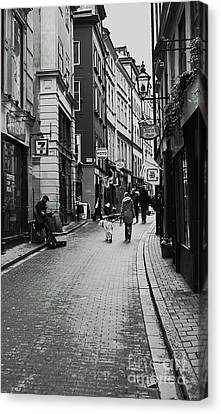 Canvas Print featuring the photograph Walking In Gamla Stan by Louise Fahy