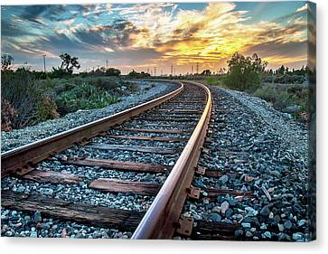 Walking The Rails Canvas Print by Aron Kearney