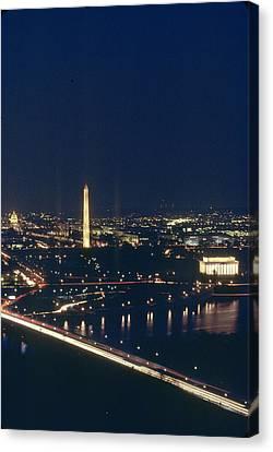 Washington D.c. At Night, Seen Canvas Print by Kenneth Garrett
