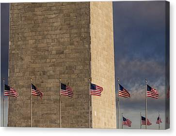Washington Monument And Usa Flags Canvas Print by Susan Candelario