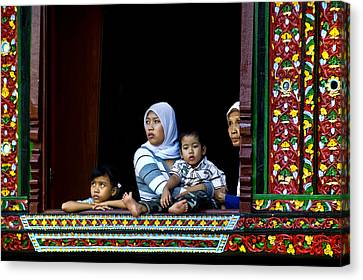 Watching From A Window Canvas Print by Charuhas Images