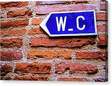 Water Closet Sign On A Brick Red Wall Canvas Print by Sami Sarkis