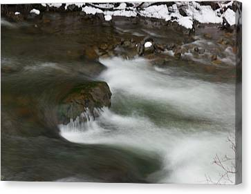 Water Pouring Over A Boulder Canvas Print