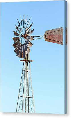 Water Pump Windmill On Blue Sky Background Canvas Print by David Gn