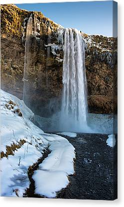 Canvas Print featuring the photograph Waterfall Seljalandsfoss Iceland In Winter by Matthias Hauser