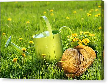 Watering Can In The Grass Canvas Print by Sandra Cunningham