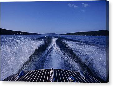 Waves Left In The Wake Of A Boat Canvas Print by Kenneth Garrett
