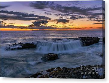 Canvas Print featuring the photograph Wave Over The Rocks by Eddie Yerkish