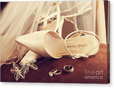 Wedding Shoes With Veil And Rings On Velvet Chair Canvas Print by Sandra Cunningham