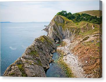 West Lulworth Lagoon The Natural Lagoon Behind The Jurassic Cliffs West Of Lulworth Cove Dorset Canvas Print by Andy Smy