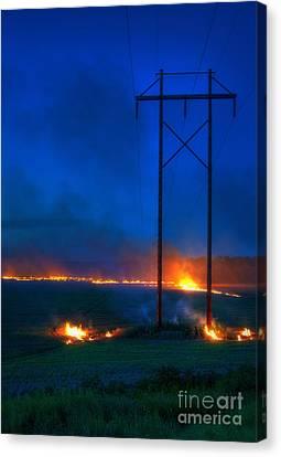 Wheat Stubble Burn Canvas Print by Fred Lassmann