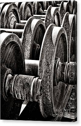 Wheels On Wheels Canvas Print by Olivier Le Queinec