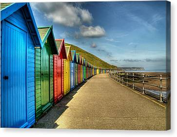 Whitby Beach Huts Canvas Print by Sarah Couzens