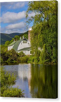 Canvas Print featuring the photograph White Barn Reflection In Pond by Paula Porterfield-Izzo