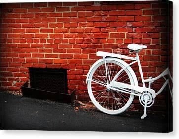 White Bike On Red Brick Canvas Print by Susie Weaver