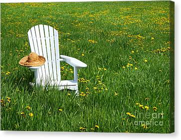 White Chair With Straw Hat Canvas Print by Sandra Cunningham