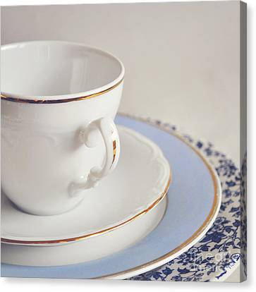 Canvas Print featuring the photograph White China Cup, Saucer And Plates by Lyn Randle