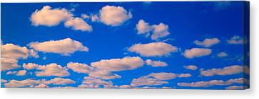 White Clouds In Blue Sky Canvas Print by Panoramic Images