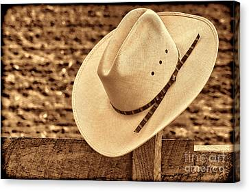 White Cowboy Hat On Fence Canvas Print by American West Legend By Olivier Le Queinec