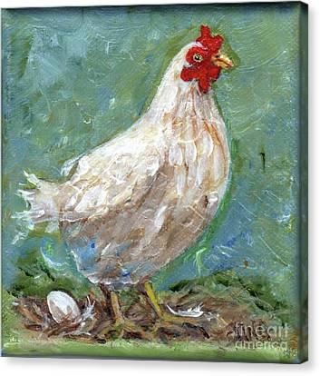 White Hen Lays Egg Canvas Print by Doris Blessington