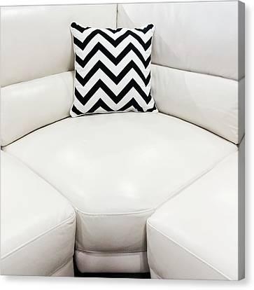 White Leather Sofa With Decorative Cushion Canvas Print