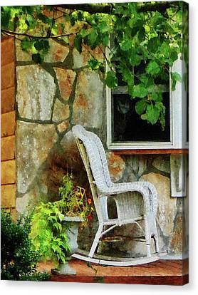 Wicker Rocking Chair On Porch Canvas Print by Susan Savad