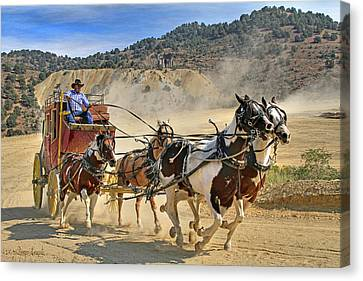 Wagon Wheels Canvas Print - Wild West Ride by Donna Kennedy