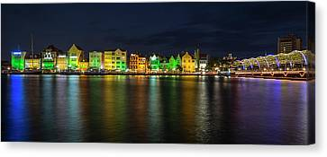 Canvas Print featuring the photograph Willemstad And Queen Emma Bridge At Night by Adam Romanowicz