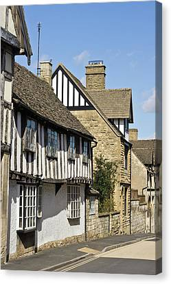Winchcombe Houses Canvas Print by Tom Gowanlock