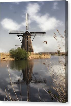 Windmill At Kinderdijk In Holland Canvas Print by Tim Abeln