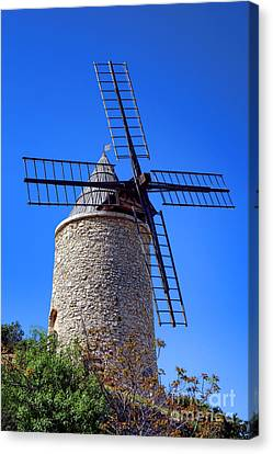Canvas Print featuring the photograph Windmill In Provence by Olivier Le Queinec