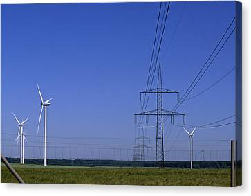 Windmills And High Voltage Transmission Canvas Print by Norbert Rosing