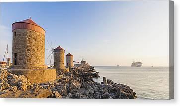 Windmills At Mandraki Harbour Canvas Print by Werner Dieterich
