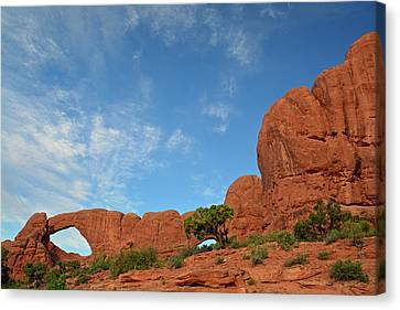 Canvas Print featuring the photograph Windows Arches With Wispy Clouds by Bruce Gourley