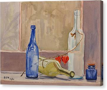 Wine Bottles On Shelf Canvas Print by Debbie Homewood