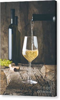 Wine In Glass Canvas Print by Mythja Photography