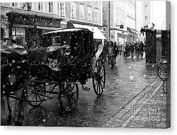 Winter Buggy In Salzburg Canvas Print by John Rizzuto