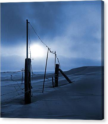 Winter Setting Sun Blue Toned Canvas Print by Donald  Erickson