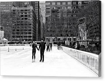 Bryant Canvas Print - Winter Skating At Bryant Park by John Rizzuto