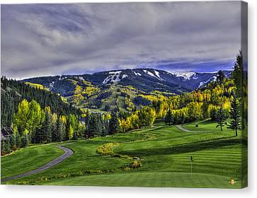 Winter Sweeps Fall Away Canvas Print by Darryl Gallegos
